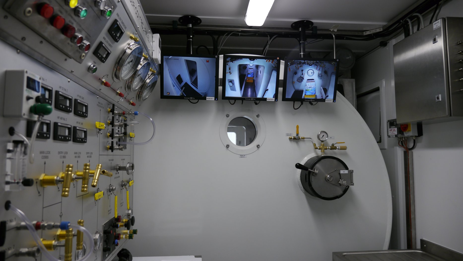 video screens displaying interior of Twin Lock Diving Chamber
