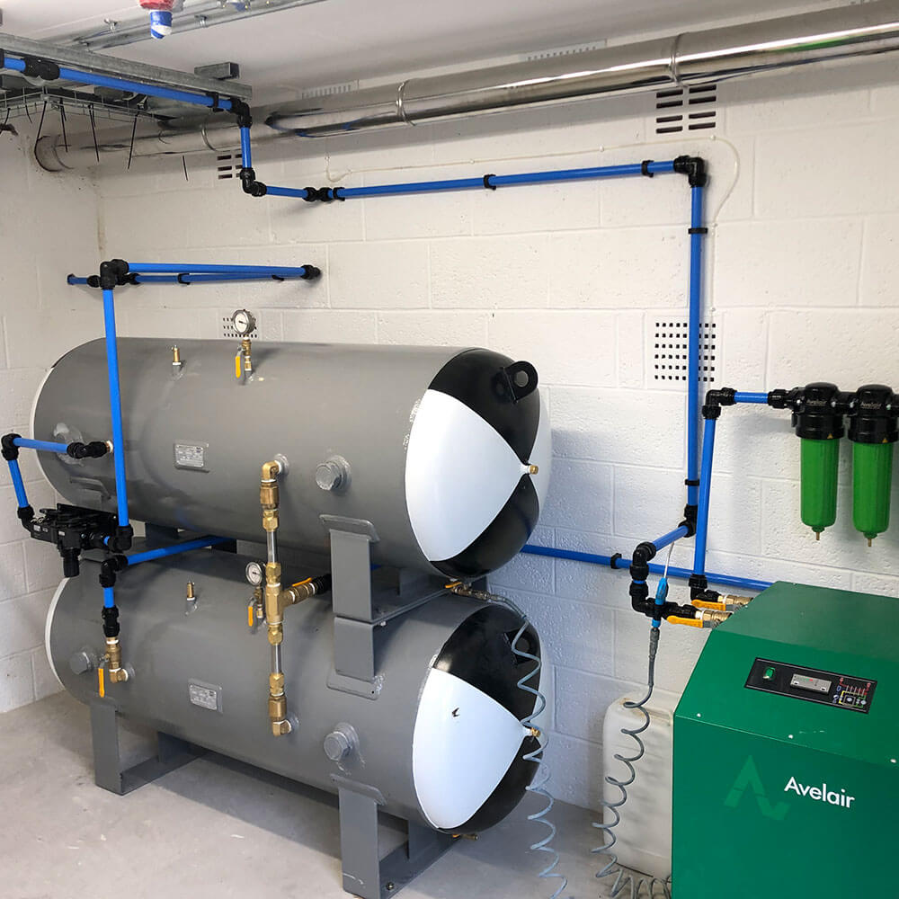 3/4 view of air compressor units for hyperbaric chamber
