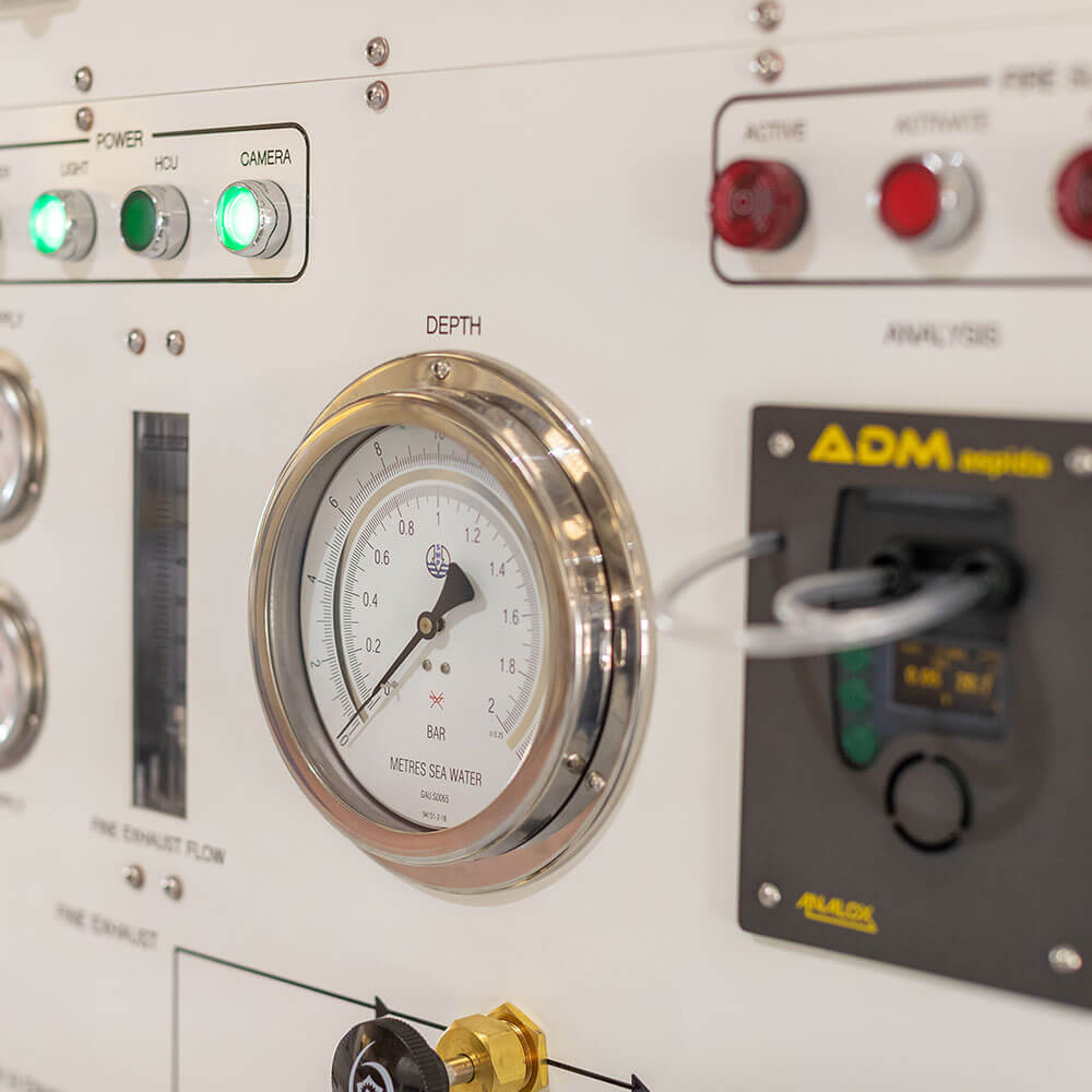 close up of depth gauge on hyperbaric chamber