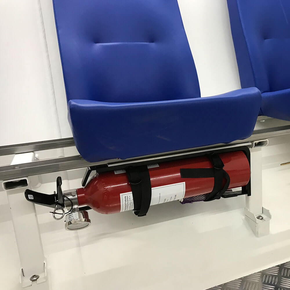 fire extinguisher under seat in hyperbaric chamber