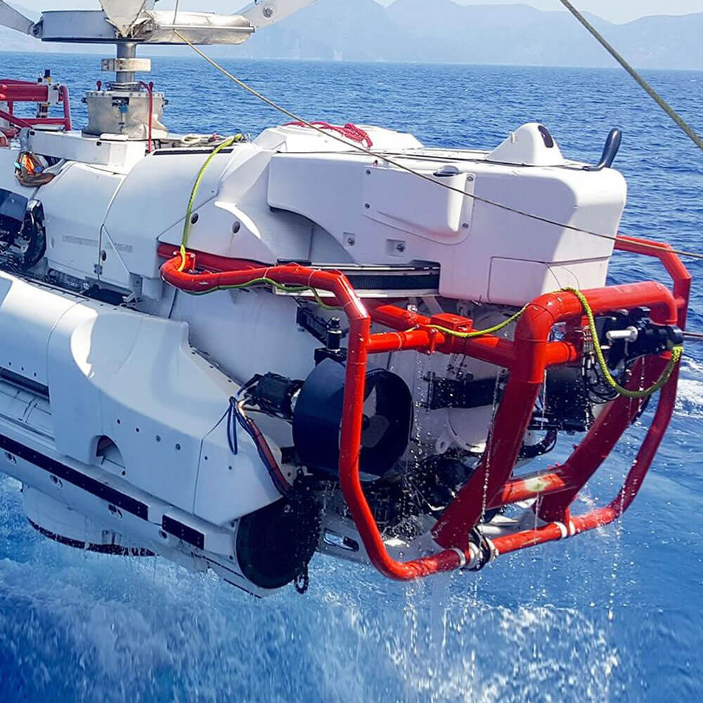 Submarine rescue system being lifted from sea