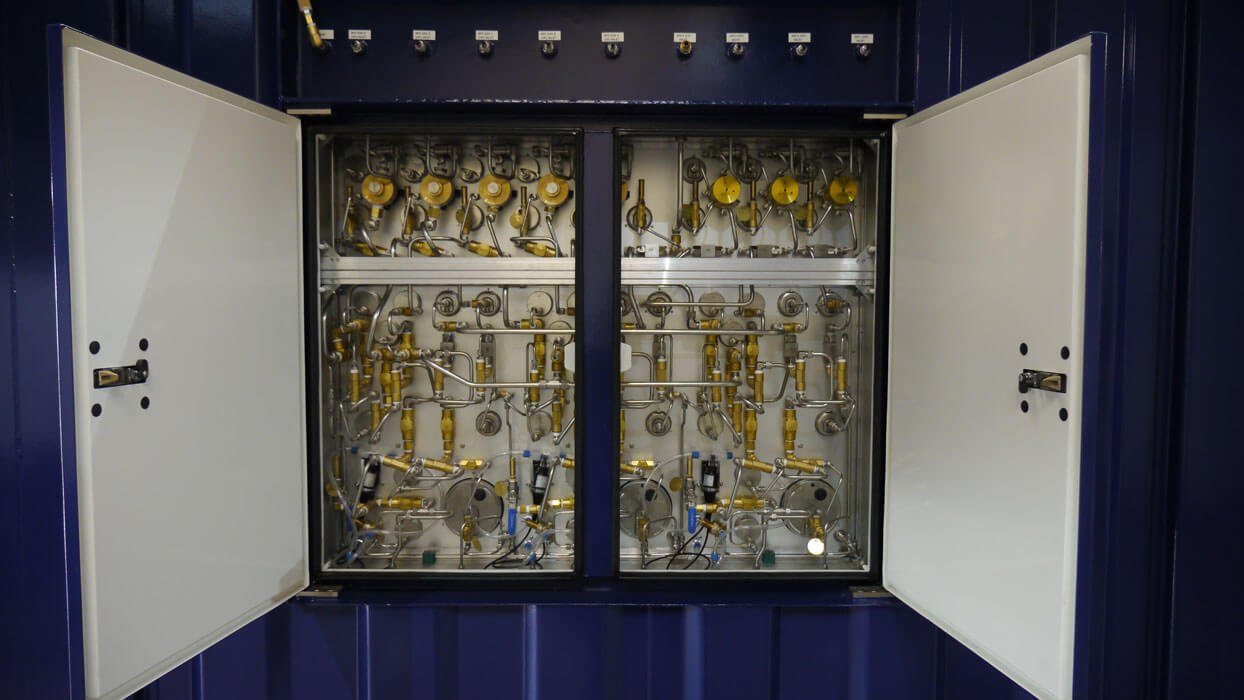 side panel exposing pipework an valves of containerised dive system