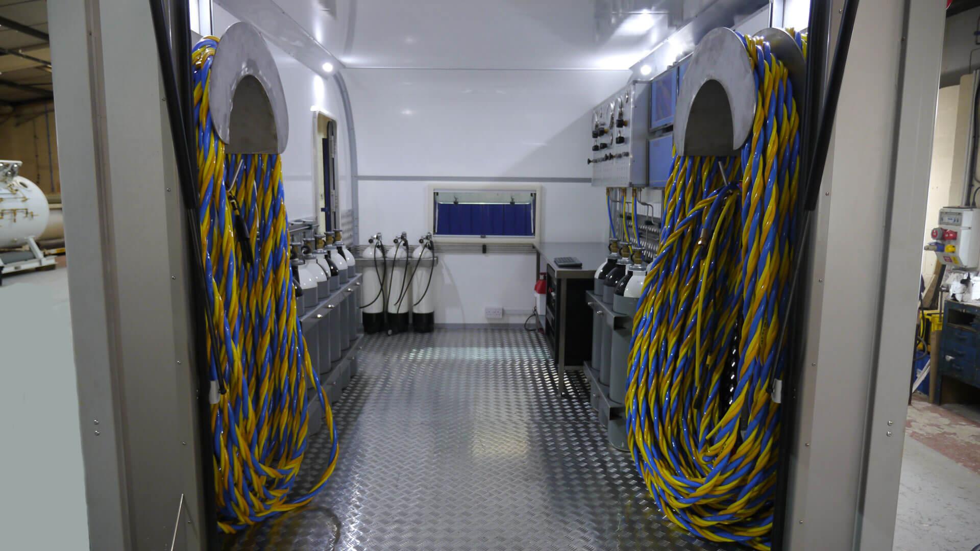 interior of dive trailer with umbilicals