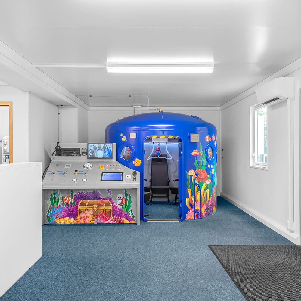 open door showing inside of hyperbaric chamber in childrens school