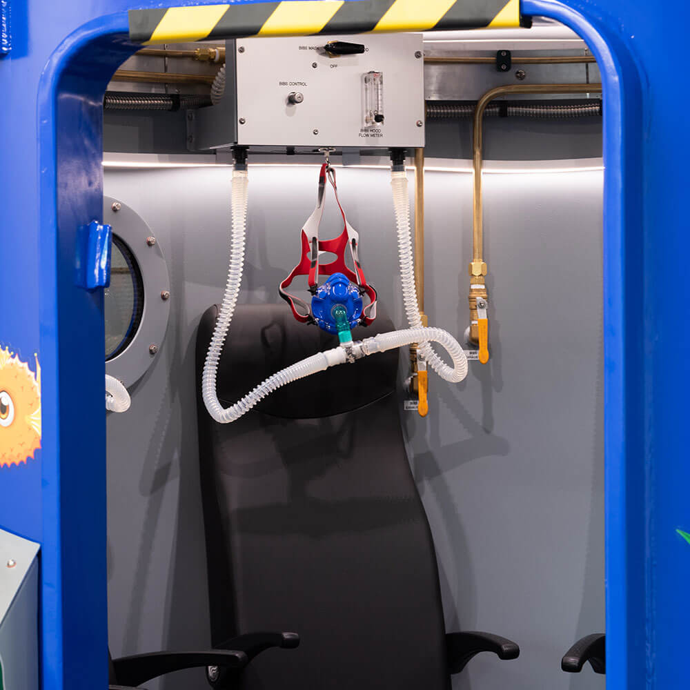 oxygen mask inside hyperbaric chamber